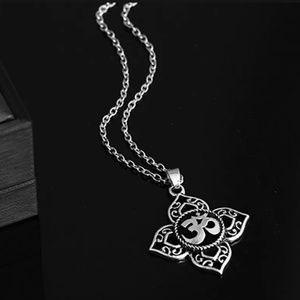Filagree cut OHM Lotus flower necklace